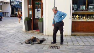 """Mike talking with a friend in Bratislava """"Man at Work"""""""