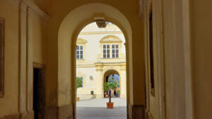 Entrance in and out of courtyard of Chateau Valtice, CZ